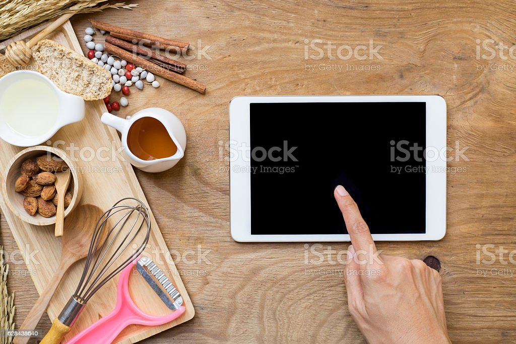 woman searching the cooking menu and preparing food ingredient b stock photo