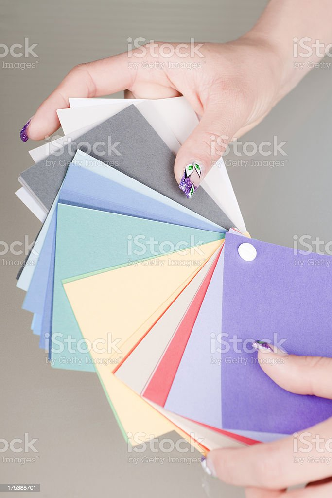 Woman Selecting Colour for Decorating royalty-free stock photo