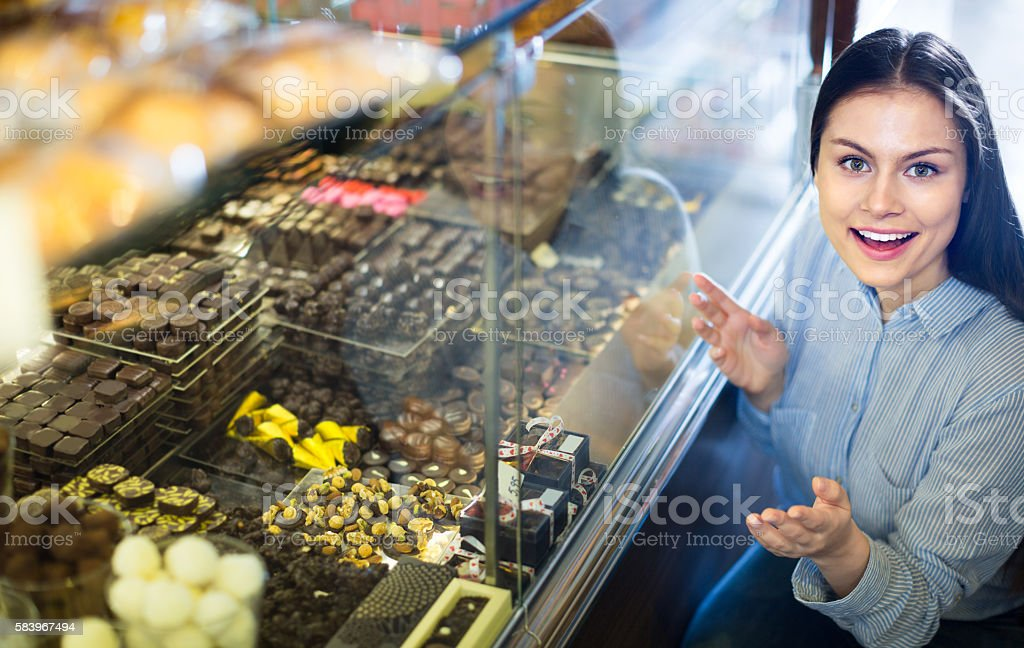 woman selecting fine chocolates stock photo