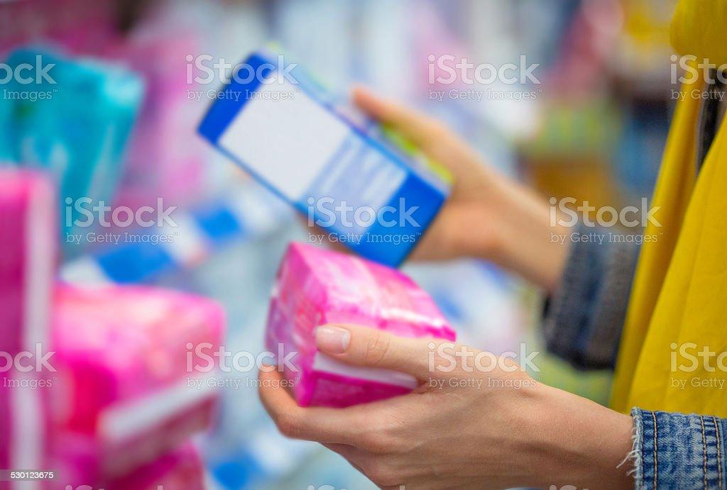 Woman selecting tampon stock photo