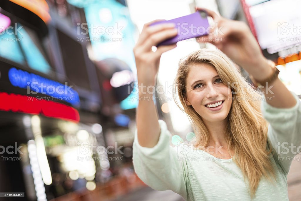 woman self photographing in times square - NYC stock photo
