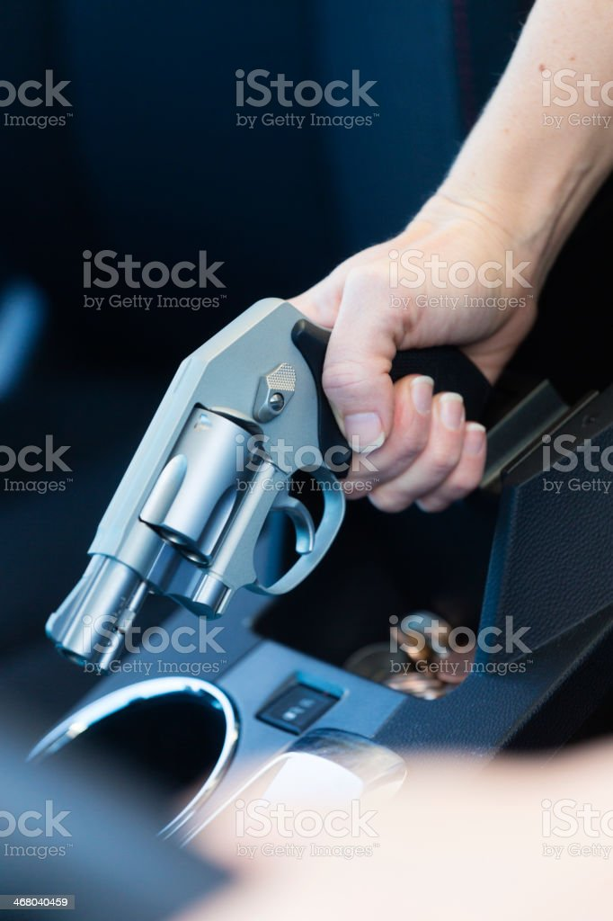 Woman Self-Defense with Handgun royalty-free stock photo