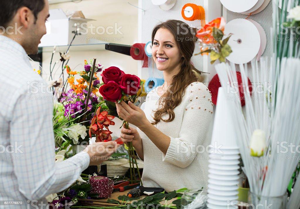 woman seller offering flowers man stock photo