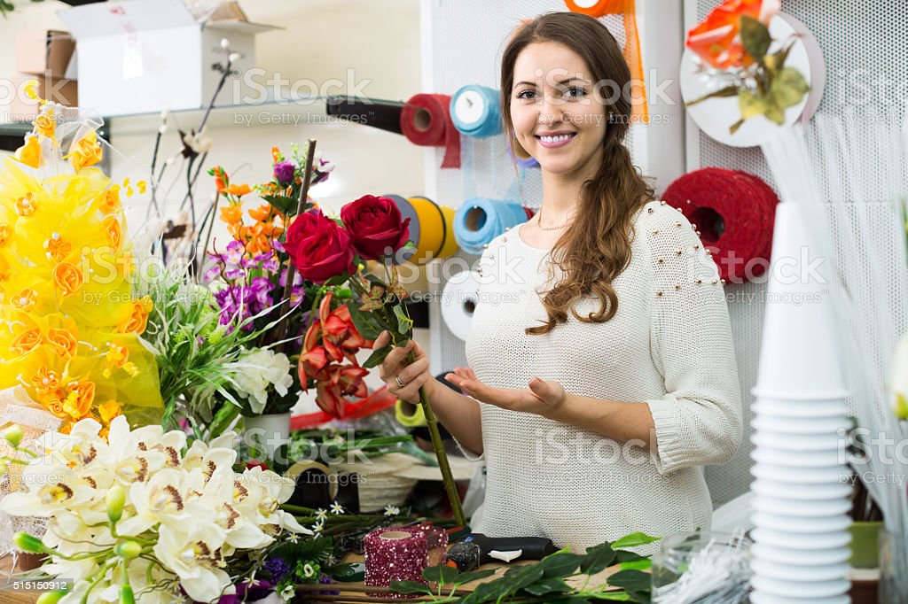 woman seller offering flowers stock photo
