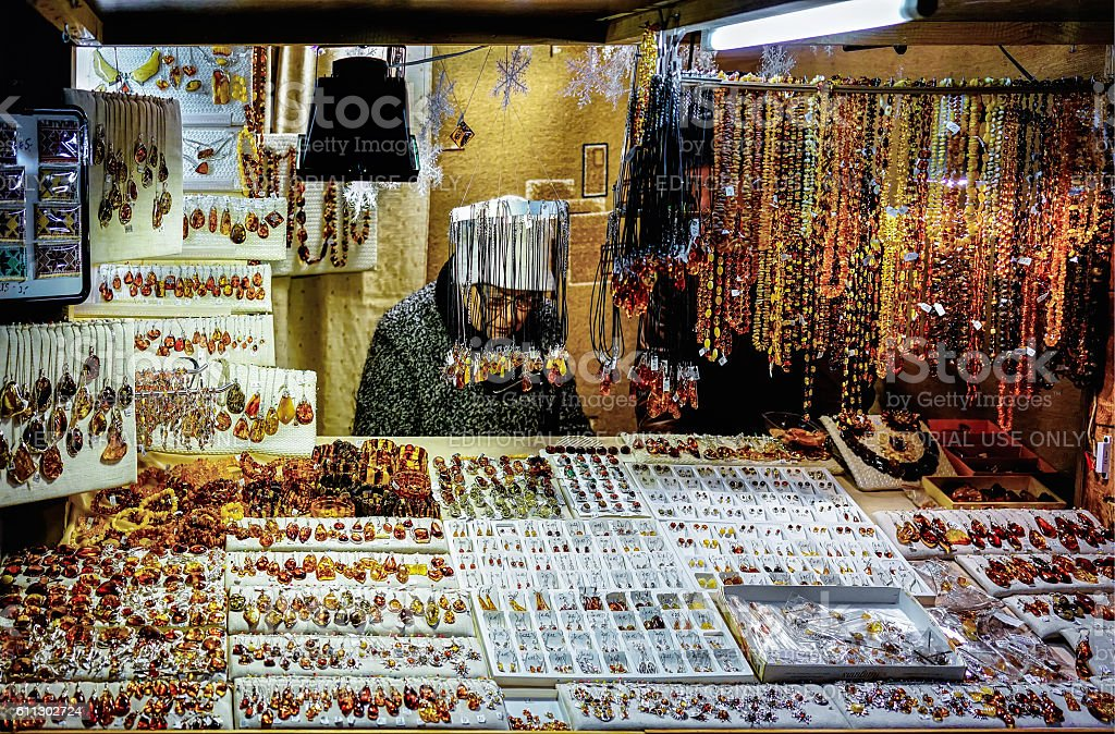 Woman selling amber embellishments in Riga Christmas Market stock photo