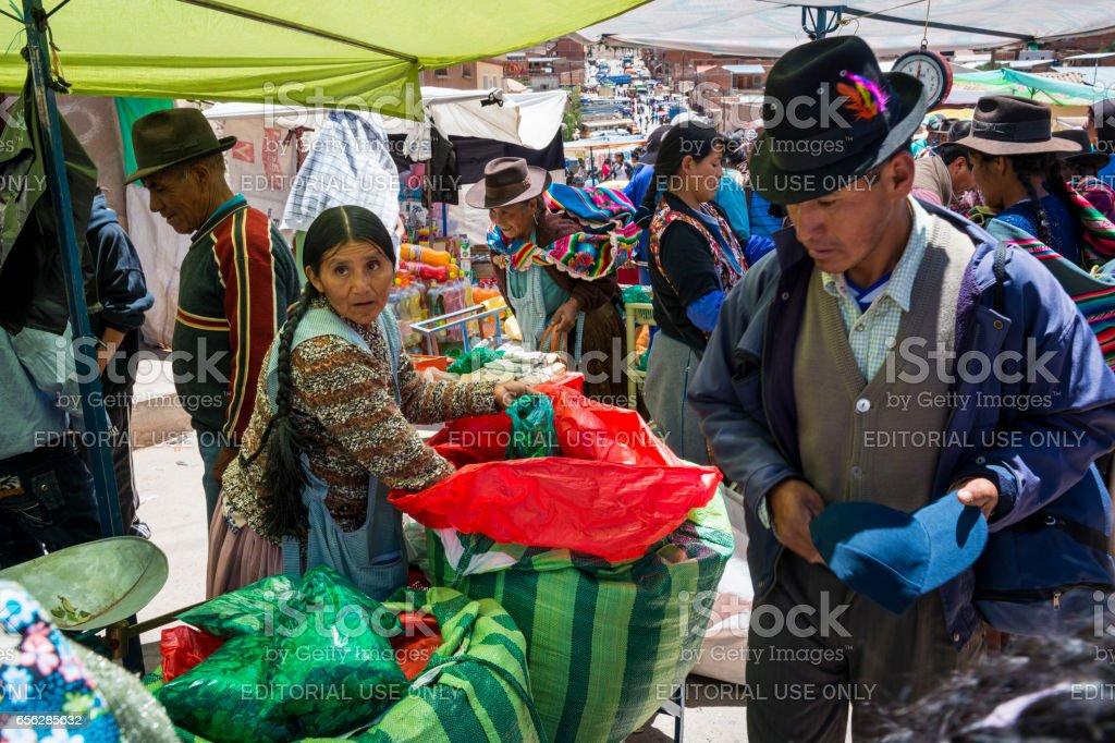 Woman selling coca leaves in a street market in the small town of Betanzos stock photo
