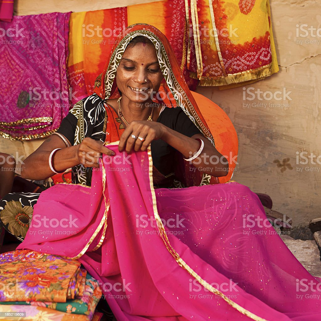 Woman selling colorful fabrics royalty-free stock photo