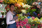 Woman selling flowers at the florist