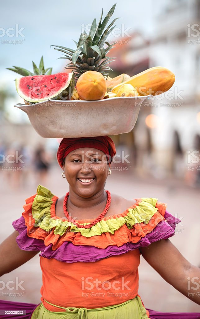 Woman selling fruits in Cartagena stock photo