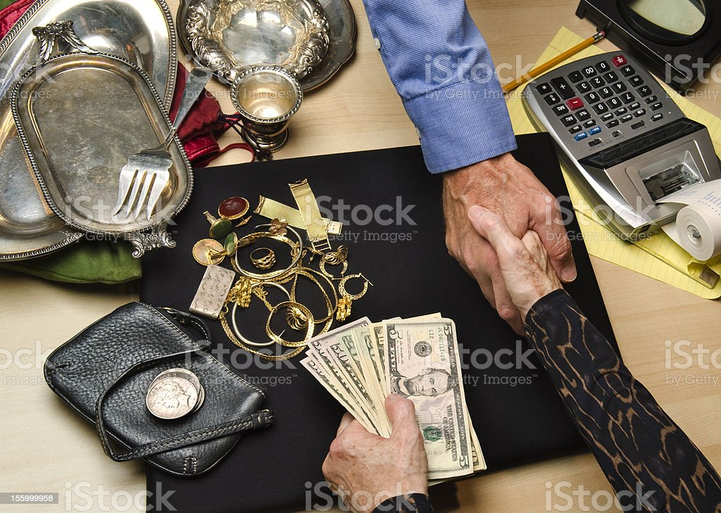 woman selling gold and silver stock photo