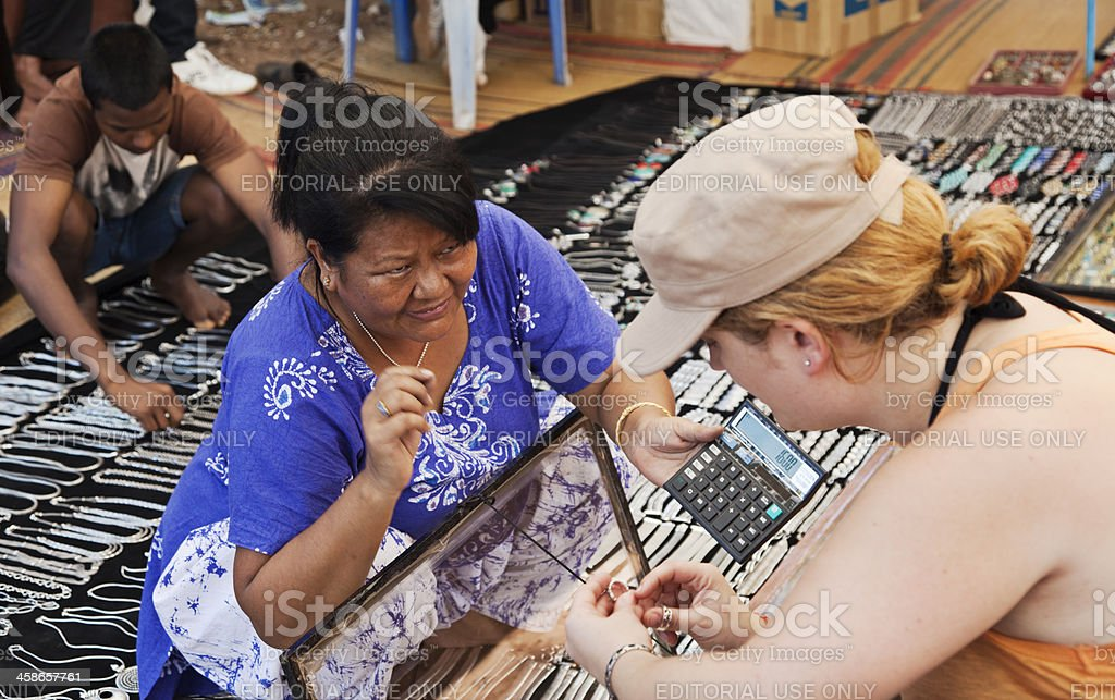 Woman selling jewelry royalty-free stock photo