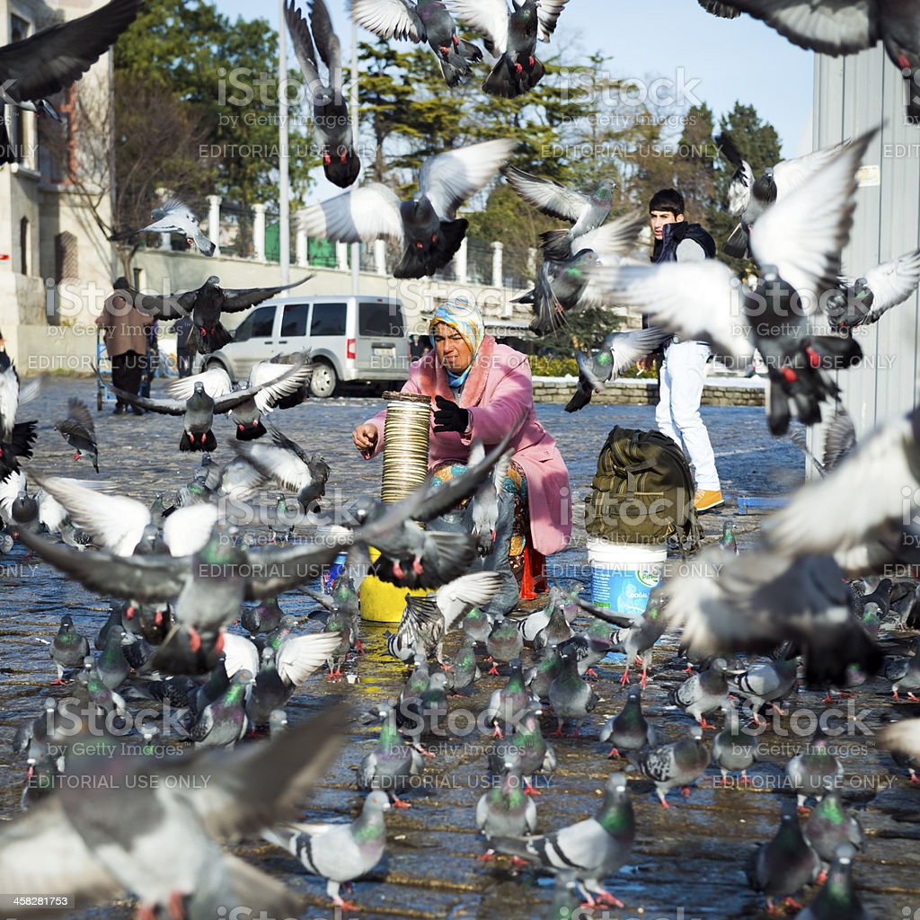 Woman selling pigeon food in Istanbul, Turkey royalty-free stock photo