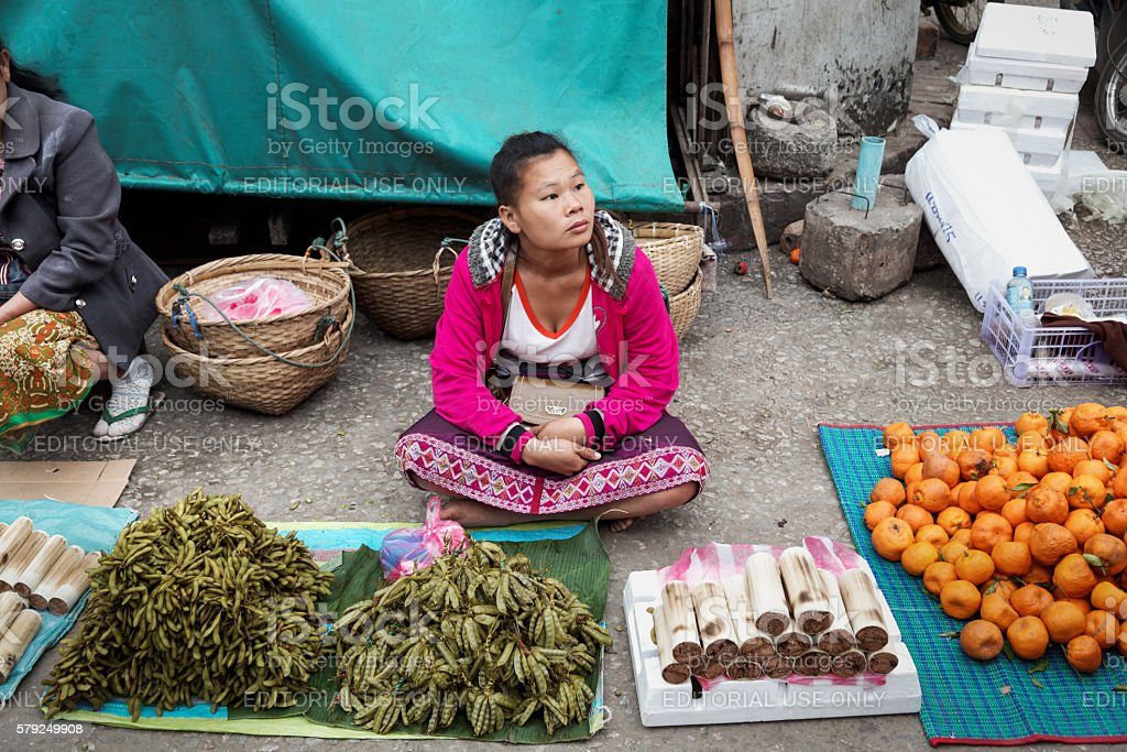 Woman selling vegetables in the morning market in Luang Parabang stock photo