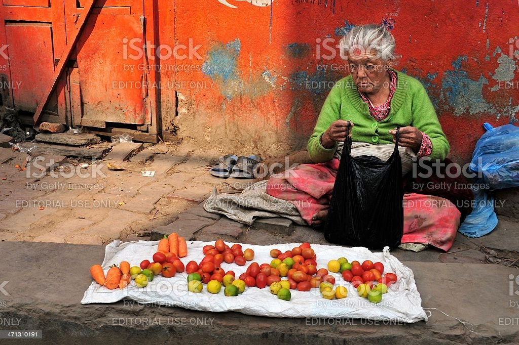 Woman selling vegetables stock photo