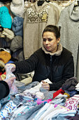 Woman selling warm clothes at Vilnius Christmas Market