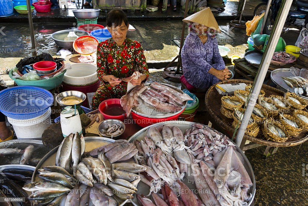 Woman sells fish on street market in My Tho, Vietnam stock photo