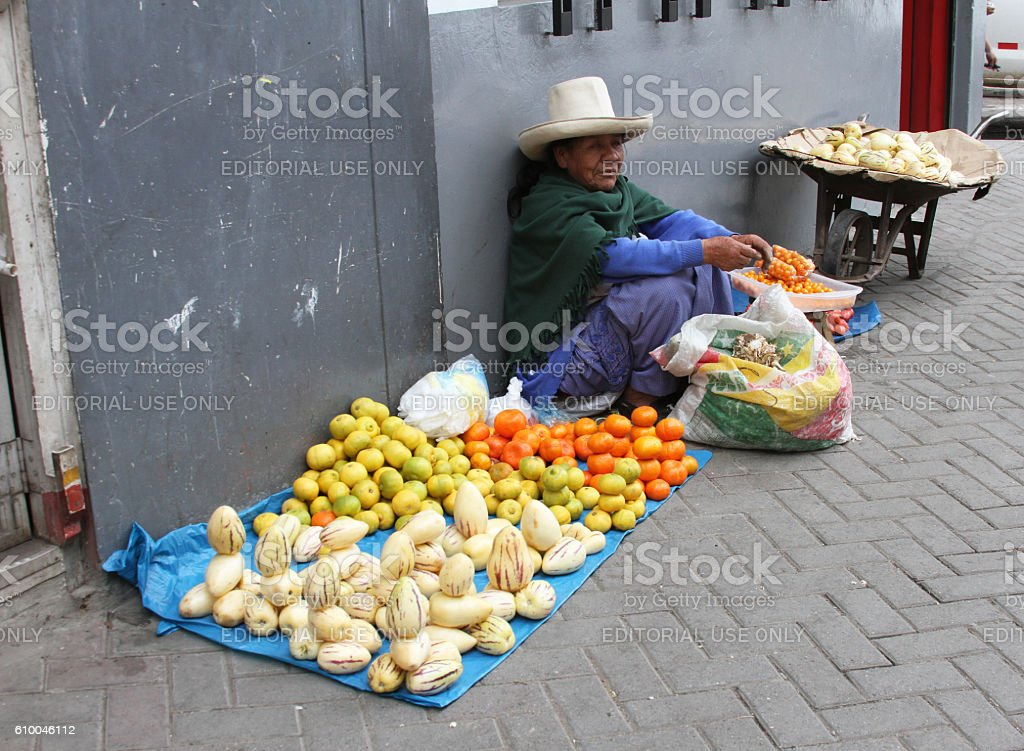 Woman Sells Fruit on Street in Peru stock photo