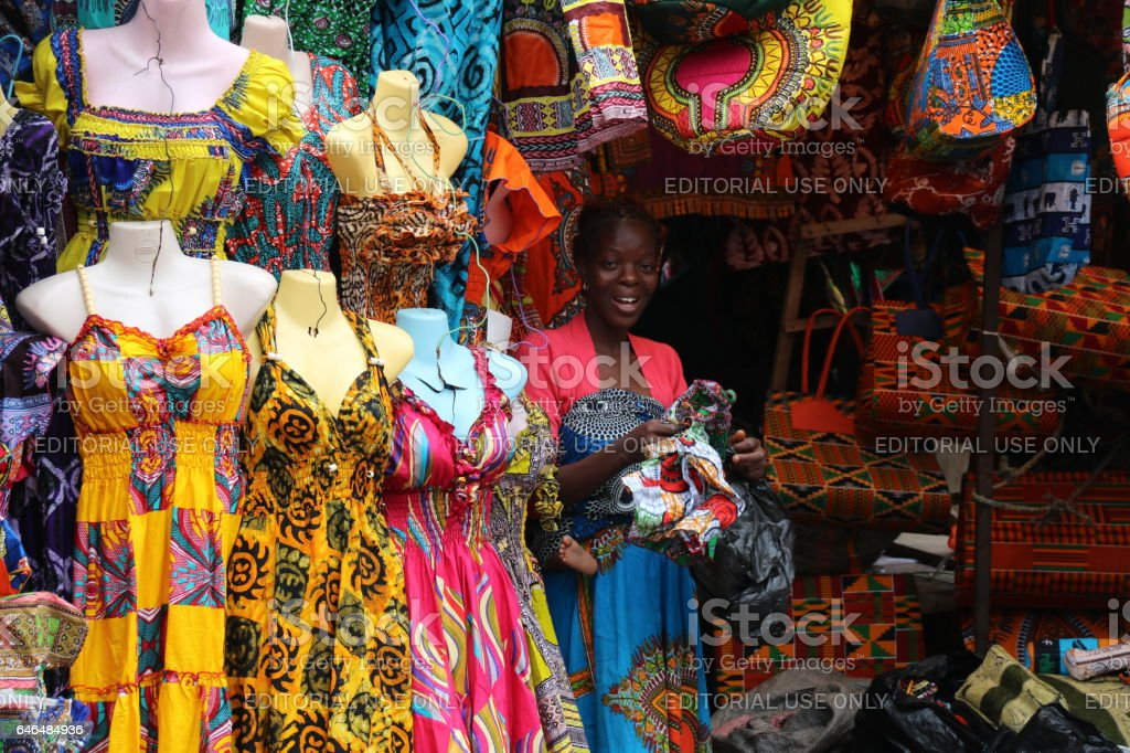 Woman sells Traditional African Textiles Stall, Lomé, Togo, West Africa stock photo