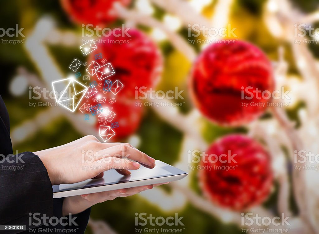 Woman sending email stock photo