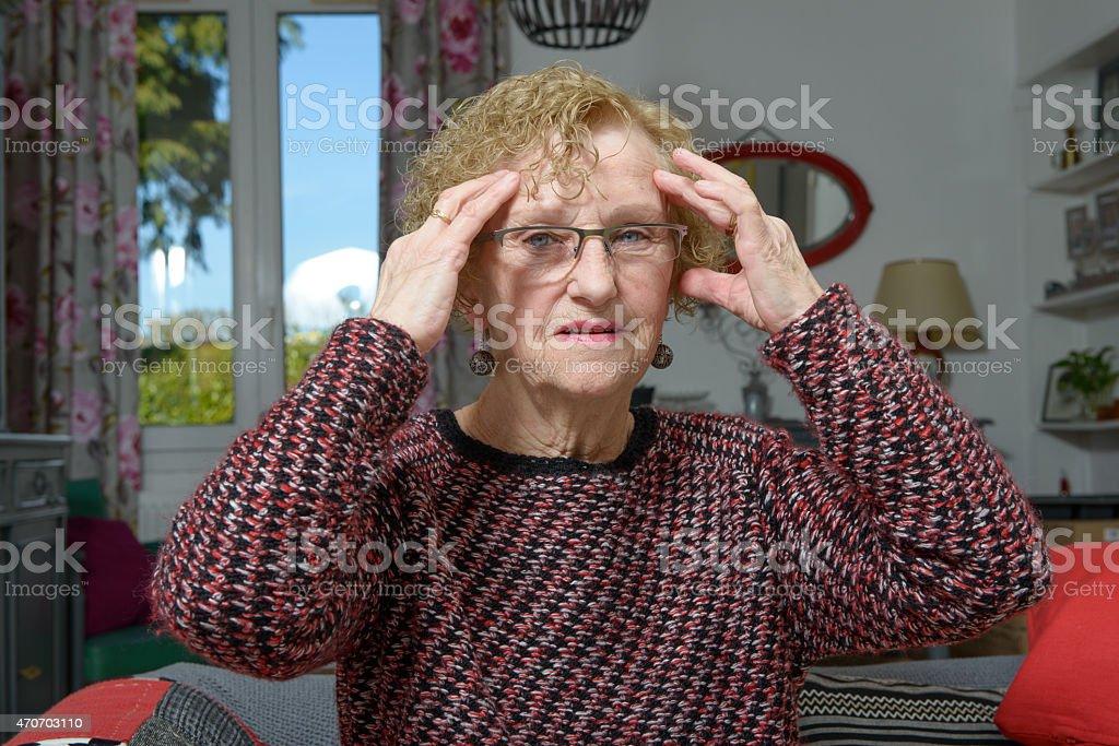 woman  senior has a headache stock photo