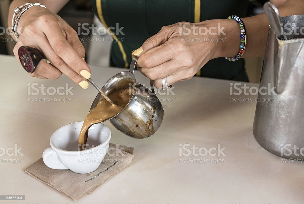 Woman serving a cuban coffee stock photo