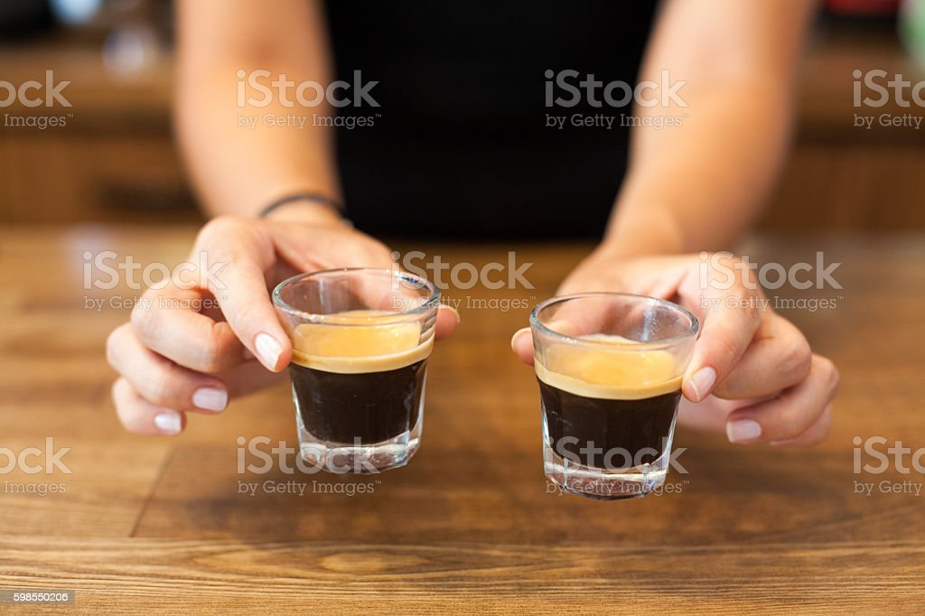 woman serving espresso stock photo