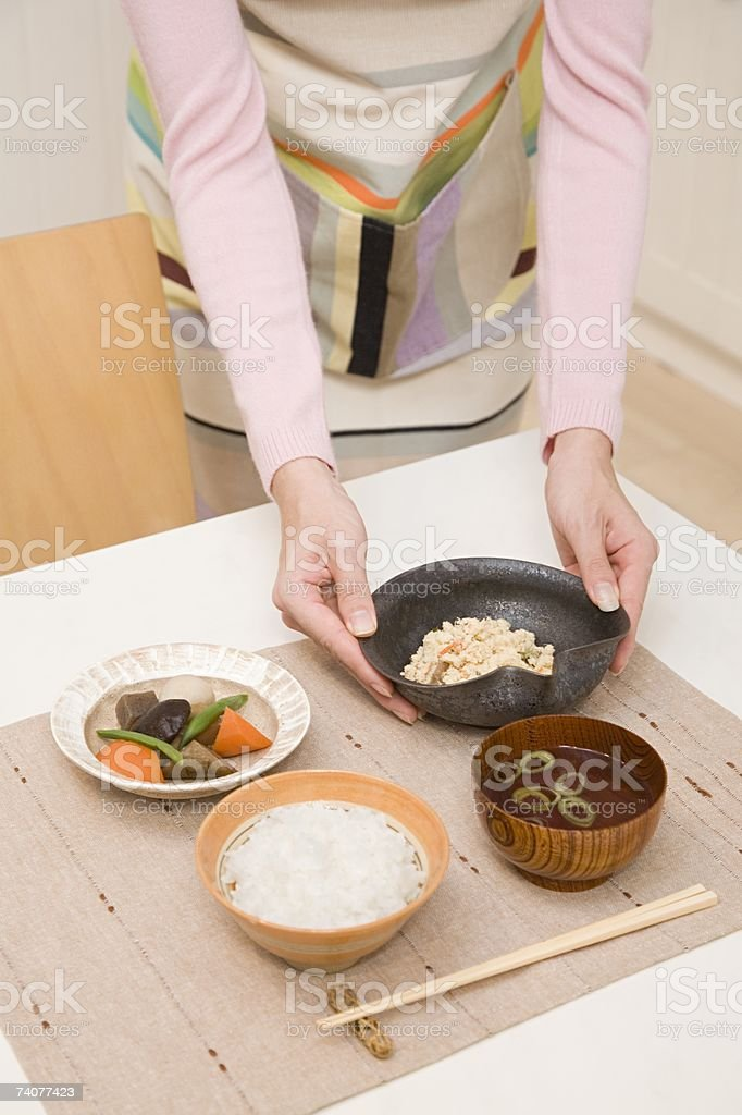 Woman serving meal royalty-free stock photo