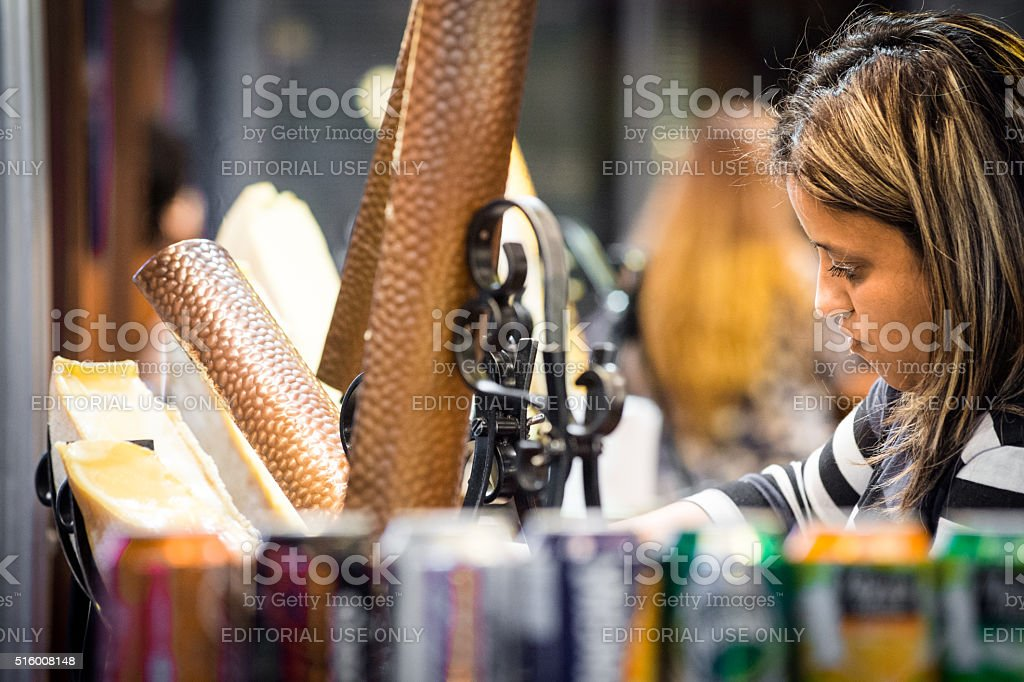 Woman serving raclette stock photo
