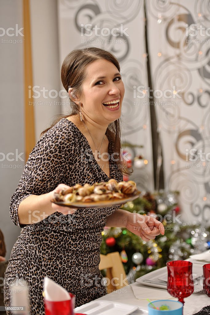 woman serving table stock photo