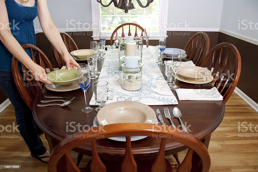 Woman Setting Table royalty-free stock photo