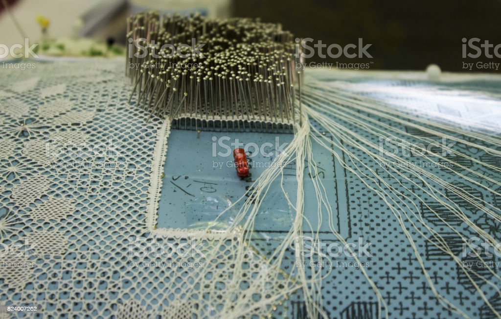 Woman sewing bobbins stock photo