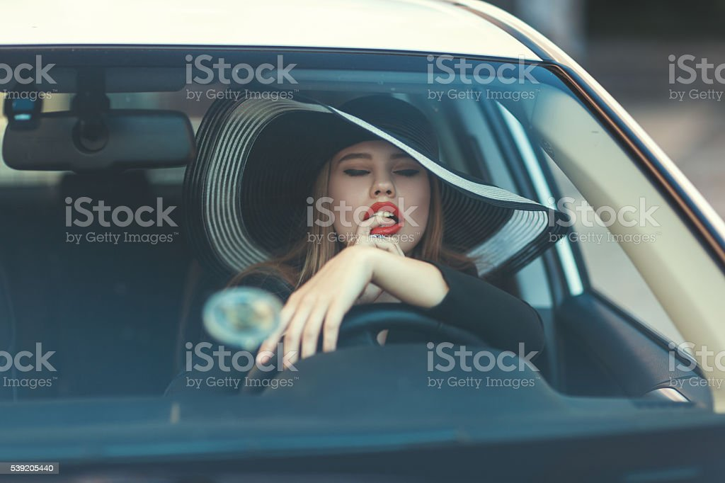 Woman sexually placed his finger in mouth. stock photo