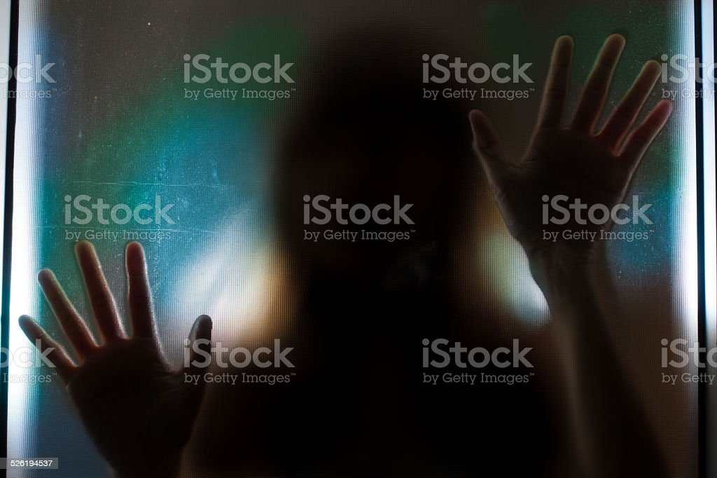 Woman shadow behind translucent mirror. stock photo