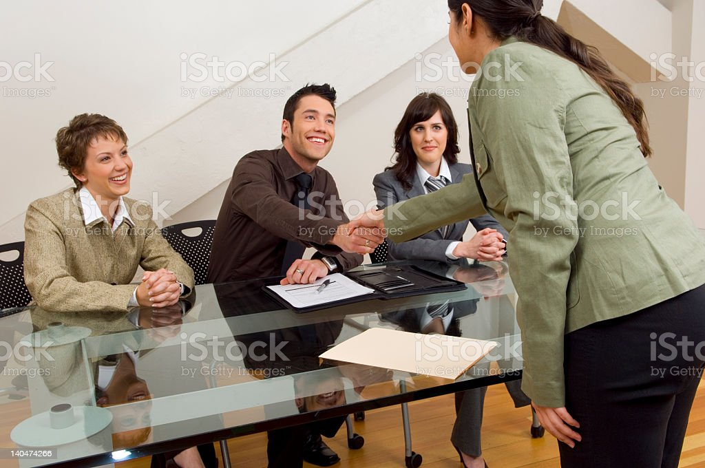 Woman shaking hands during interview with company manager royalty-free stock photo