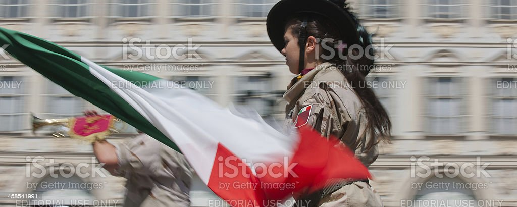 Woman sharpshooter soldier waving the italian tricolor flag royalty-free stock photo