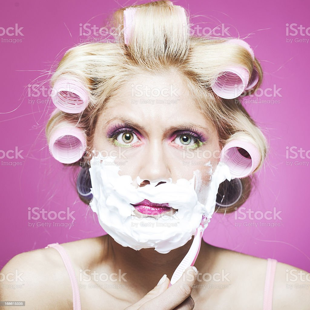 Woman shaving in front of the mirror. royalty-free stock photo