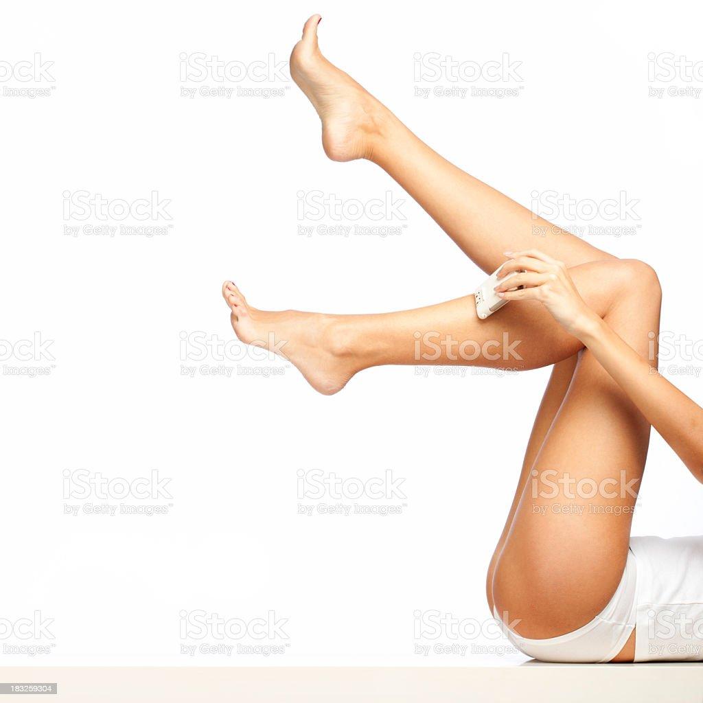 Woman Shaving Legs stock photo