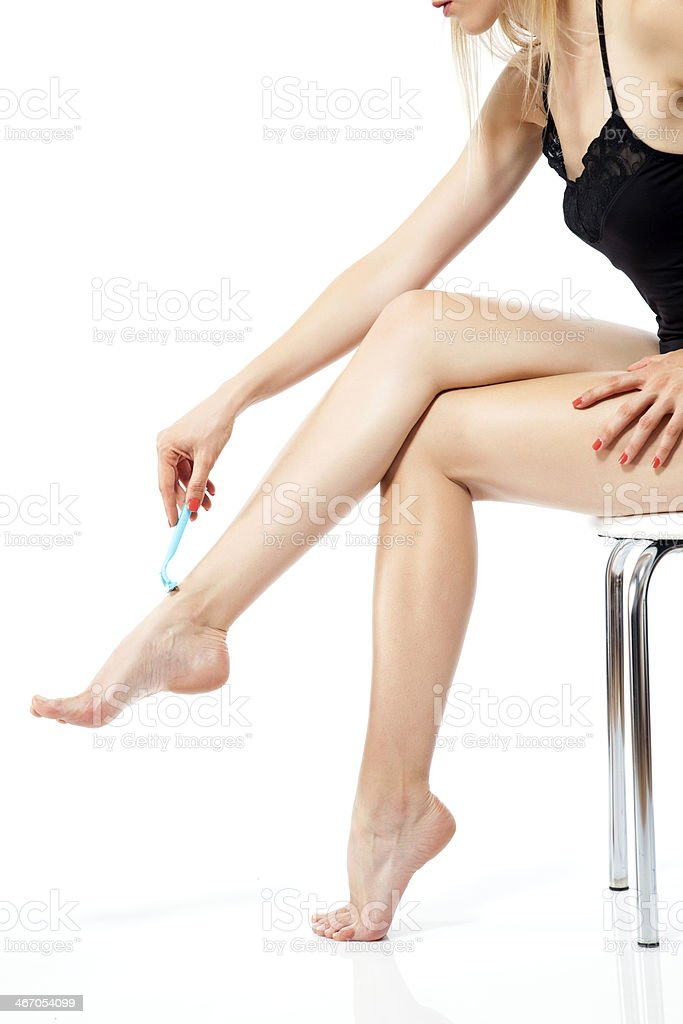 Woman shaving legs royalty-free stock photo