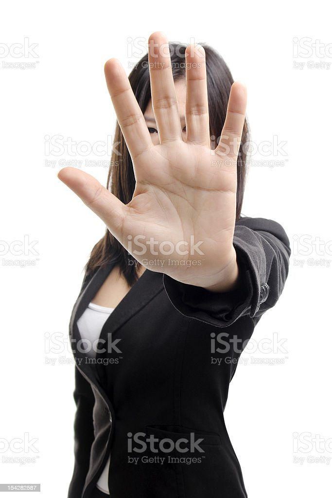 Woman shielding her face by putting her hand up stock photo