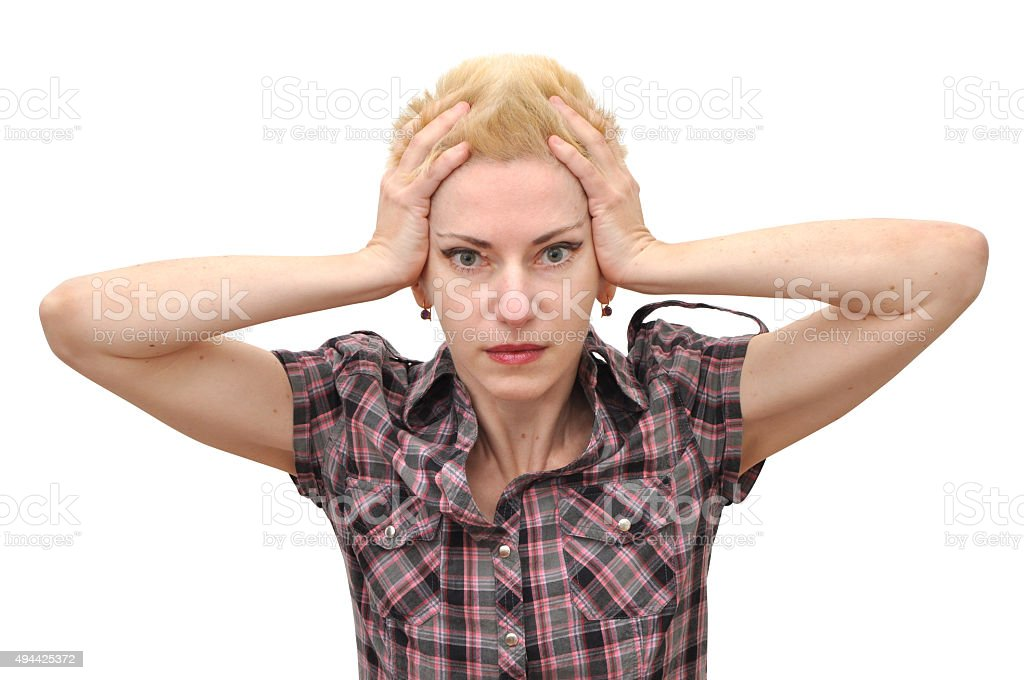 Woman shocked holding her head stock photo