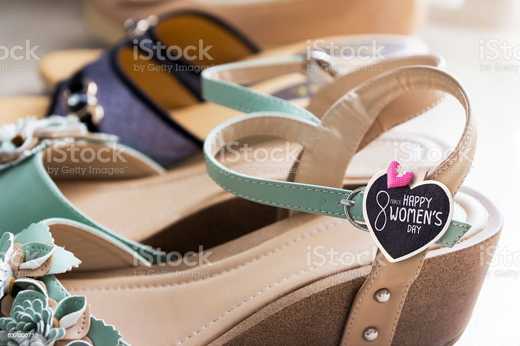 Woman shoes on wooden floor stock photo