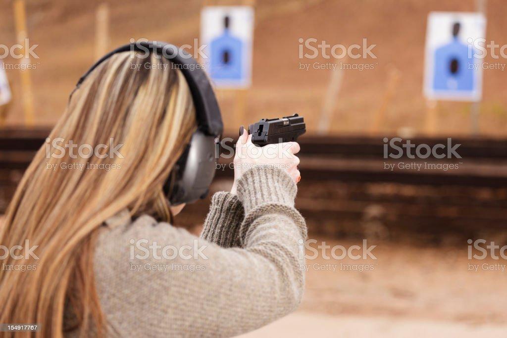 Woman Shooter at the Shooting Range stock photo