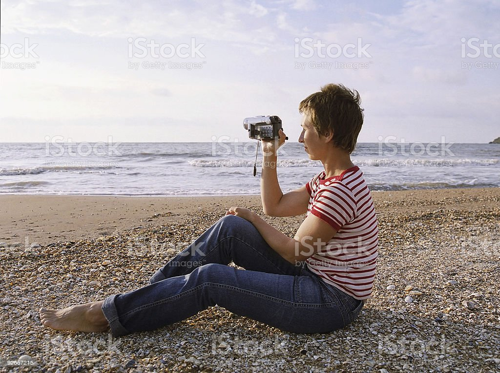 woman shooting by camcorder stock photo