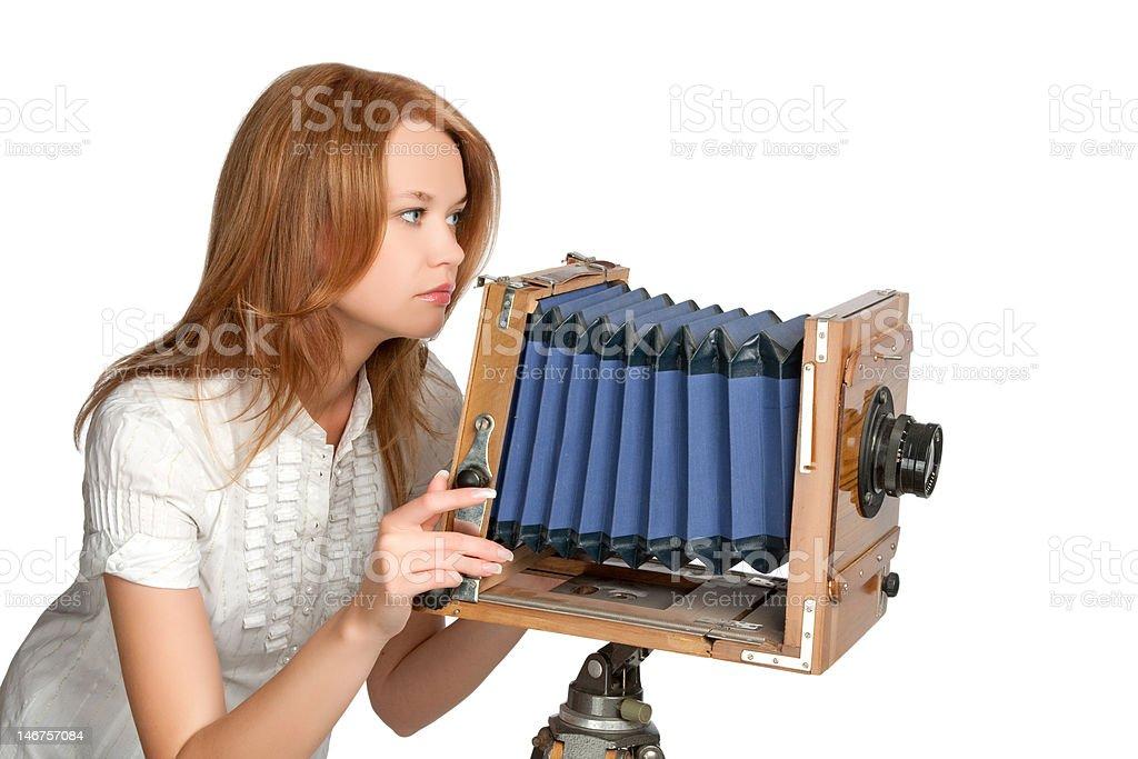 woman shooting photos with vintage camera stock photo