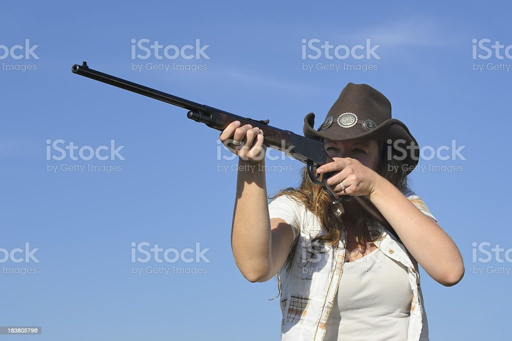 Woman Shooting Rifle Outdoors, Western Clothing royalty-free stock photo