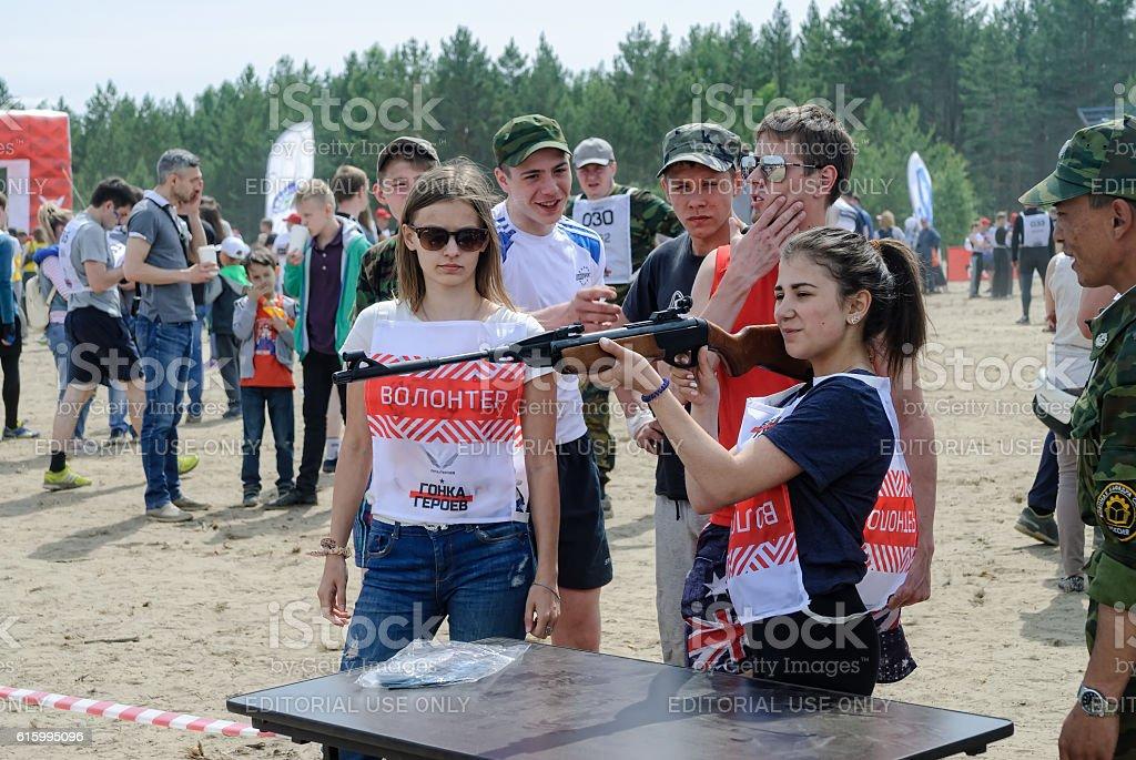 Woman shooting with air rifle gun stock photo