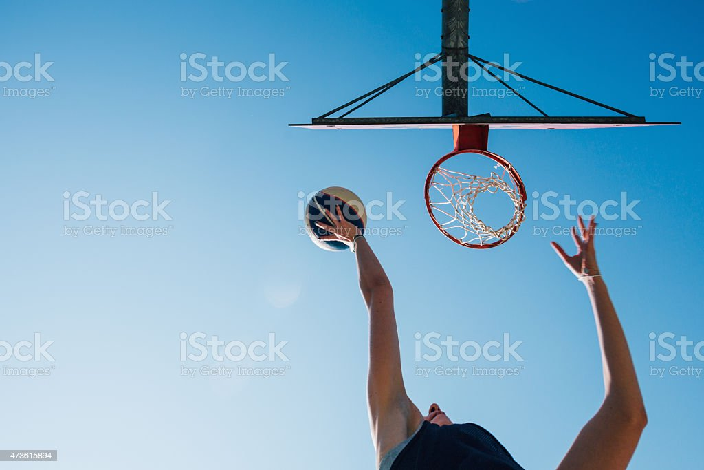woman exercising in basketball court. Shot for goal.