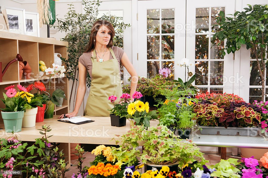 Woman Shopkeeper, Small Business Retail Garden Flower Store Owner, Worker royalty-free stock photo