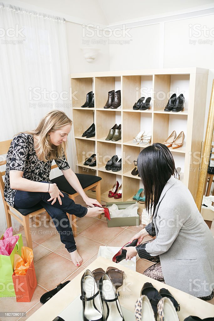 Woman Shopper and Sales Clerk in Retail Shoes Store Vt royalty-free stock photo