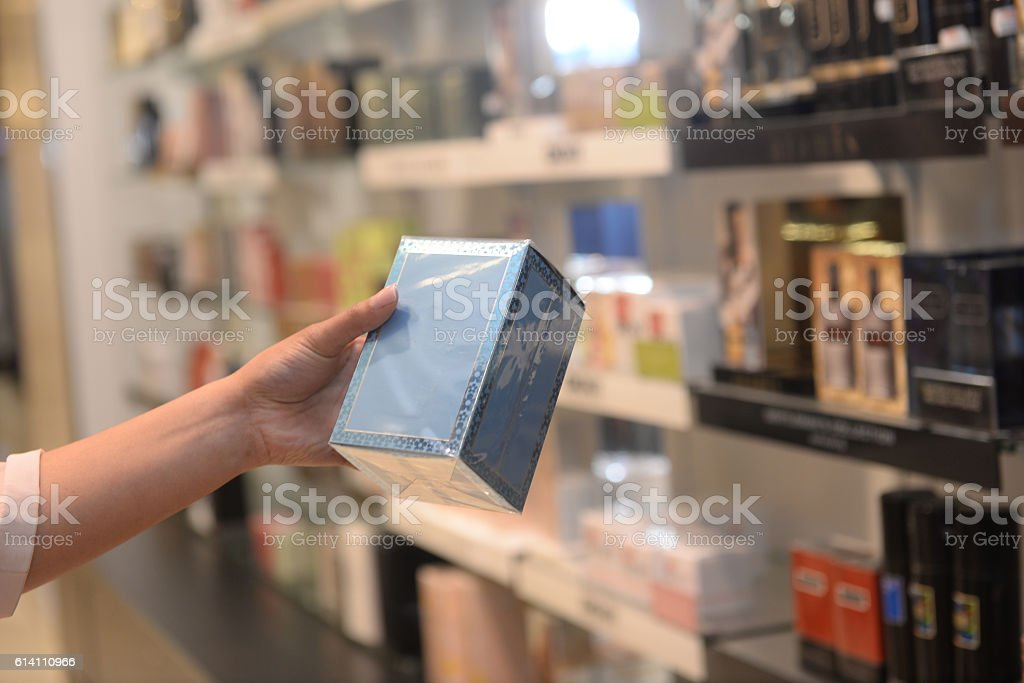 Woman shopper looking at a cosmetic box stock photo
